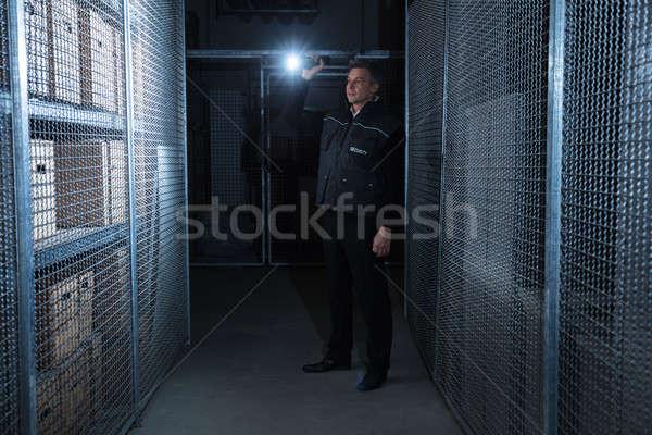 Biztonsági őr áll raktár hátsó nézet tart elemlámpa Stock fotó © AndreyPopov