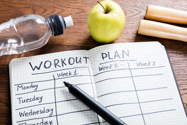 Training plan notebook houten Stockfoto © AndreyPopov