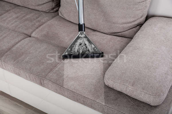 Kadın temizlik kanepe elektrikli süpürge ev Stok fotoğraf © AndreyPopov