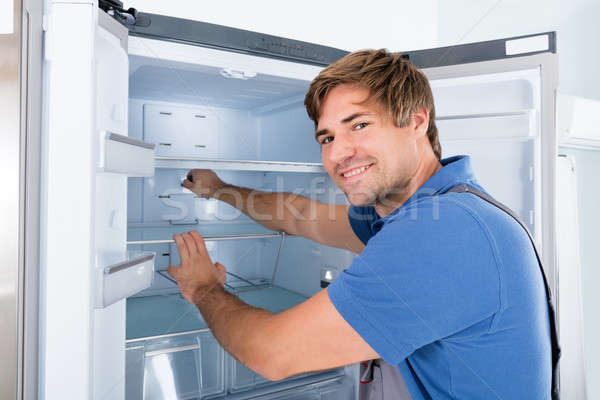 Technician Examining Refrigerator Stock photo © AndreyPopov
