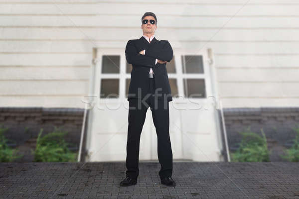 Security Guard Standing Outside The Building Stock photo © AndreyPopov