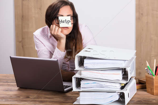 Businesswoman With Text Help On Sticky Note Stock photo © AndreyPopov