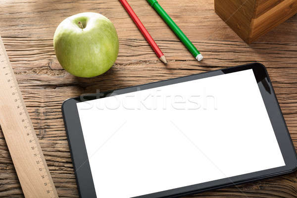 Apple With Digital Tablet On Wooden Table Stock photo © AndreyPopov