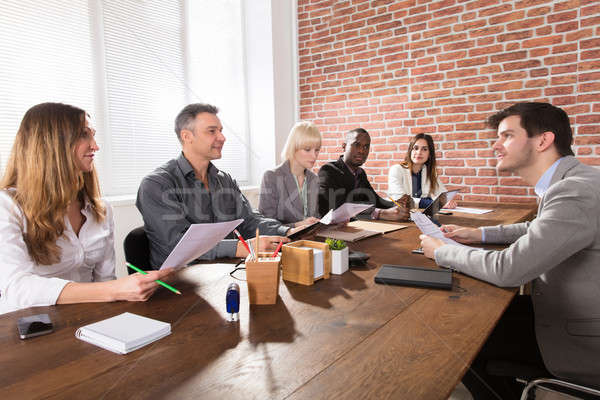 Businesspeople Discuss The New Project In Office Stock photo © AndreyPopov