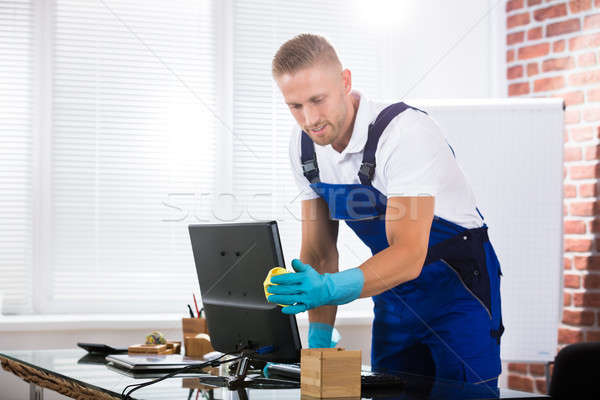 Janitor Cleaning Computer In Office Stock photo © AndreyPopov
