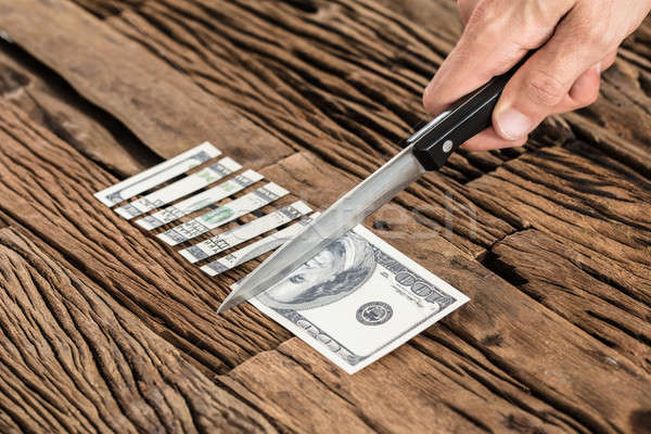 Hand Cutting The 100 Dollar Bill With Knife Stock photo © AndreyPopov