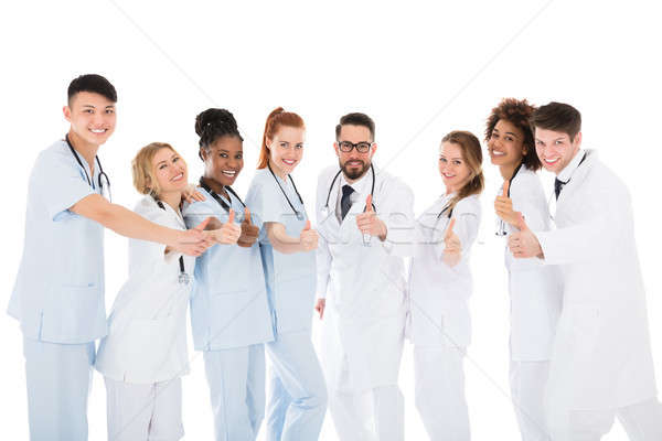 Group Of Medical Team Gesturing Thumbs Up Stock photo © AndreyPopov