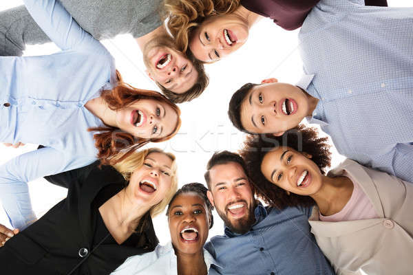 Happy Multiracial College Students Forming Huddle Stock photo © AndreyPopov