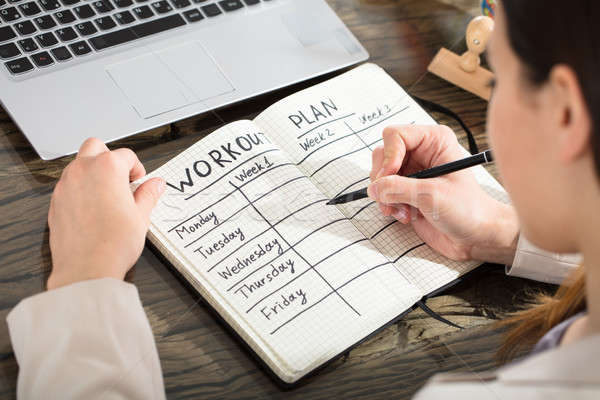 Businesswoman Writing Down A Week Plan In Diary Stock photo © AndreyPopov
