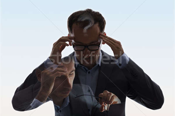 Double Exposure Of Businessman With Headache Stock photo © AndreyPopov