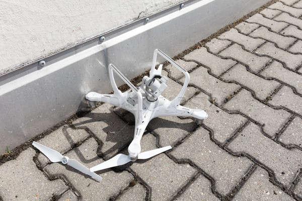 Broken drone on footpath Stock photo © AndreyPopov