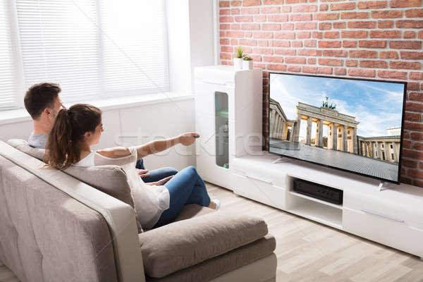 пару Смотря телевизор вид сзади сидят диване домой Сток-фото © AndreyPopov