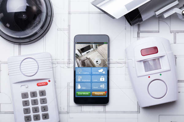 Smart Home System On Mobilephone With Security Equipment Stock photo © AndreyPopov