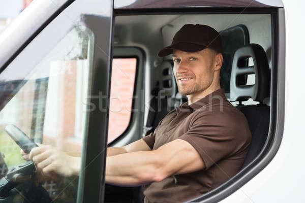 Happy Delivery Man Sitting Inside Van Stock photo © AndreyPopov