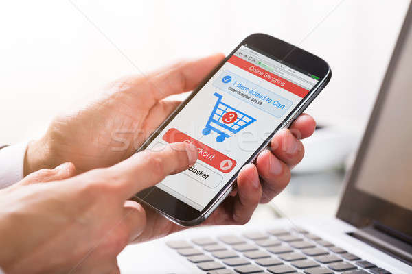 Businessperson Shopping On Mobile Phone Stock photo © AndreyPopov