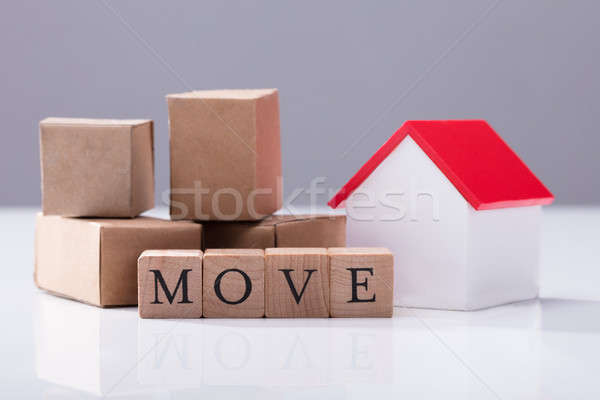 Move Text In Front Of Cardboard Boxes And House Model Stock photo © AndreyPopov