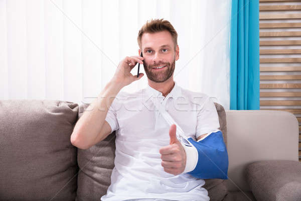 Man With Fractured Hand Gesturing Thumbs Up Stock photo © AndreyPopov