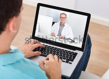 Doctor Video Conferencing With Colleague On Laptop Stock photo © AndreyPopov