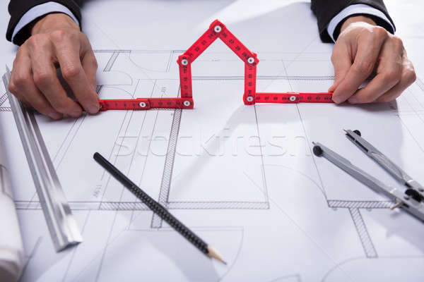 Architect Holding House Made With Red Measuring Tape Stock photo © AndreyPopov