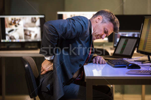 Businessman Suffering From Back Pain Stock photo © AndreyPopov
