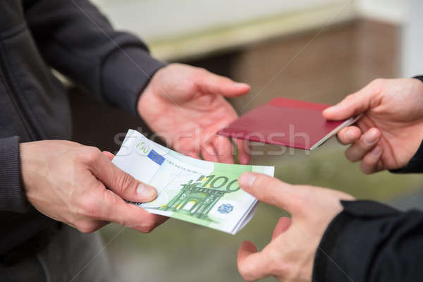 Human Hand Buying Illegal Foreign Passport Stock photo © AndreyPopov