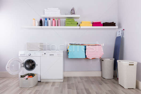 Basket Full Of Dirty Clothes In Laundry Room Stock photo © AndreyPopov