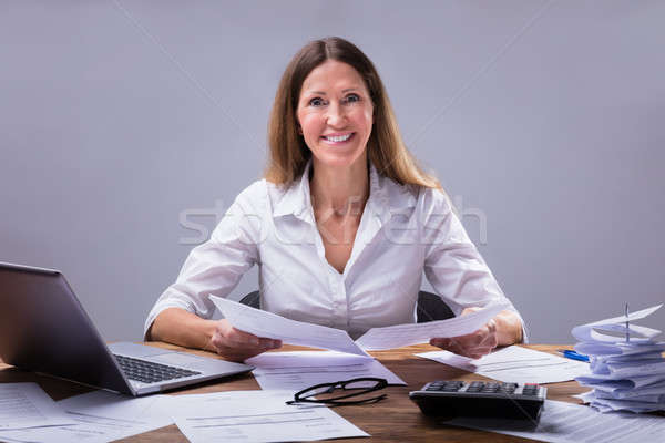 Businessperson Calculating Invoice Stock photo © AndreyPopov