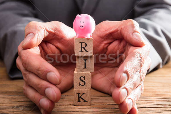 Businessperson Protecting Wooden Blocks With Risk Word Stock photo © AndreyPopov