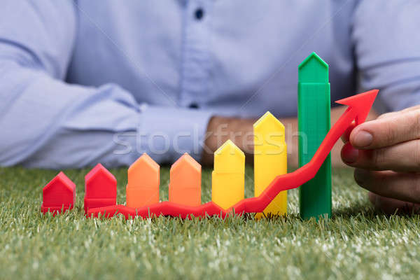 Person Holding Red Arrow In Front Of Increasing Graph Stock photo © AndreyPopov