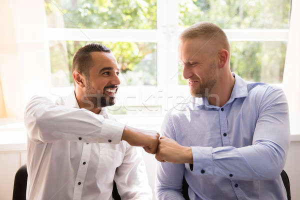 Two Business Partners Making Fist Bump Stock photo © AndreyPopov