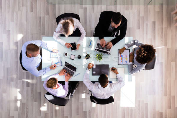 Businesspeople Working In Office Stock photo © AndreyPopov