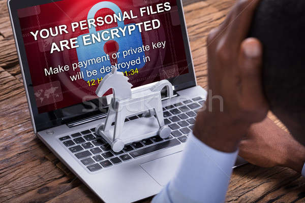 Worried Businessman Encrypted Text On The Laptop Stock photo © AndreyPopov