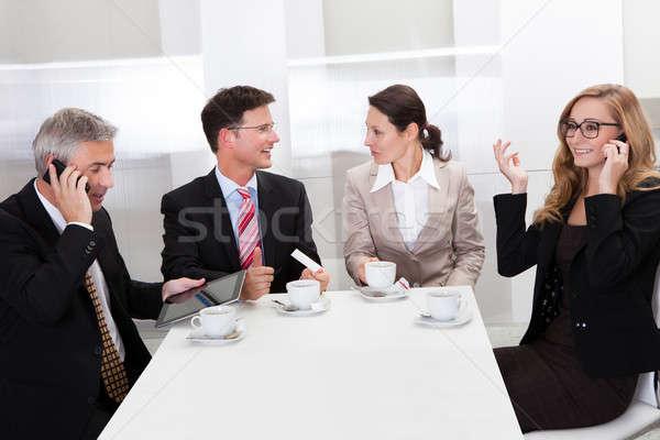 Business executives enjoying coffee Stock photo © AndreyPopov