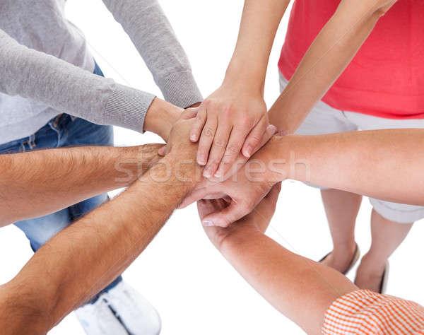 четыре случайный друзей , держась за руки Сток-фото © AndreyPopov