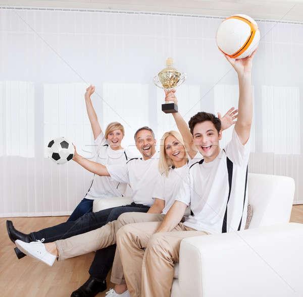 Ecstatic family celebrating a win Stock photo © AndreyPopov