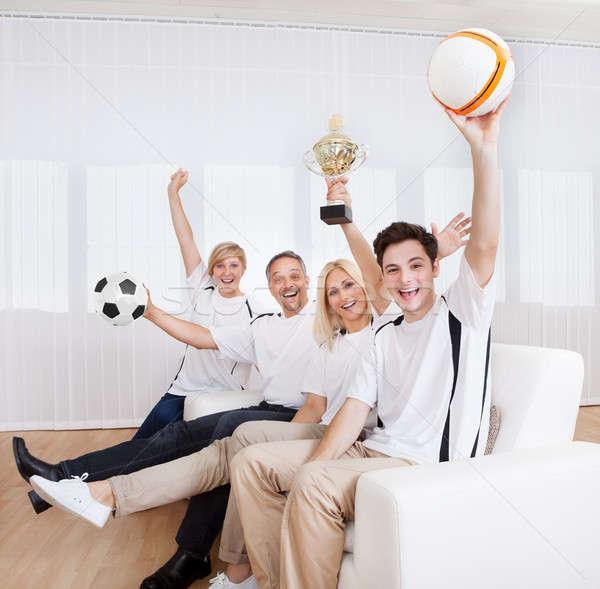 恍惚とした 家族 祝う 勝利 座って 一緒に ストックフォト © AndreyPopov