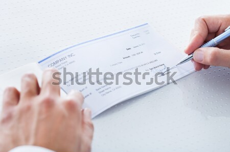 Close-up Of Hand Filling Cheque Stock photo © AndreyPopov