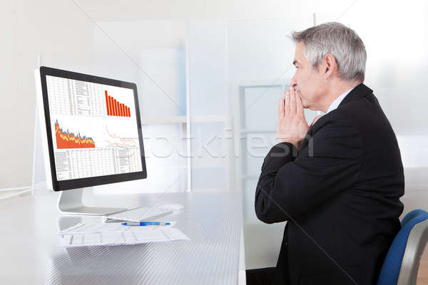 Confused Businessman With Computer Stock photo © AndreyPopov