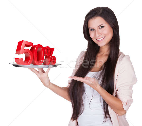 Woman presenting 50% discount on silver platter Stock photo © AndreyPopov