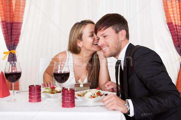 Romantic lovers sharing secrets Stock photo © AndreyPopov