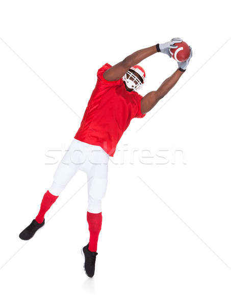 American Football Player Catching Rugby Ball Stock photo © AndreyPopov