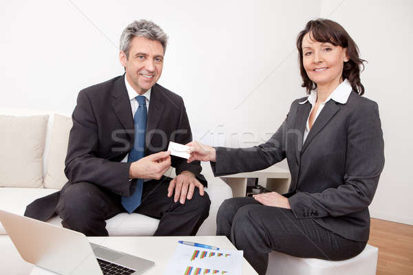 Two business people exchanging visiting card Stock photo © AndreyPopov
