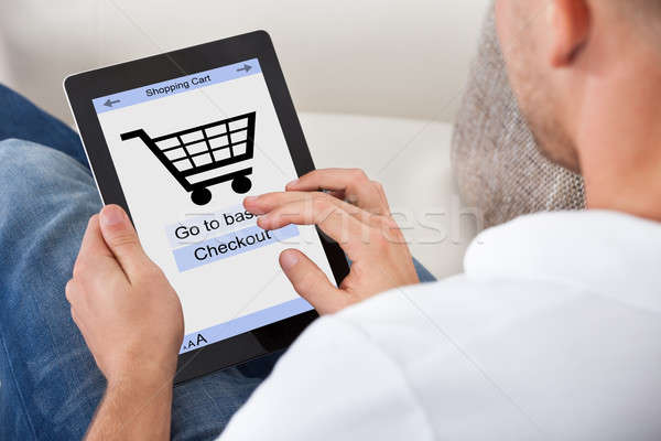 Conceptual image of a man making an online purchase Stock photo © AndreyPopov