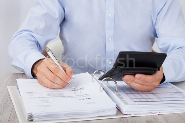 Businessman Calculating Financial Expenses Stock photo © AndreyPopov