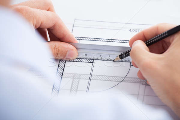 Architect Using Ruler And Pencil On Blueprint Stock photo © AndreyPopov