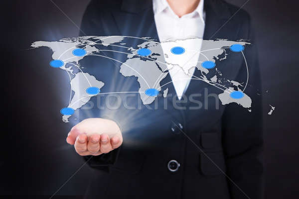 Businesswoman Showing Connected World Map Stock photo © AndreyPopov