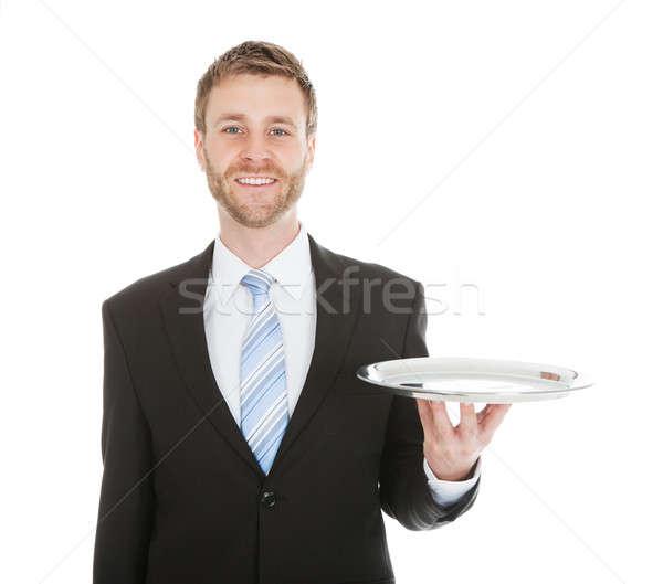 Businessman Holding Empty Tray Over White Background Stock photo © AndreyPopov