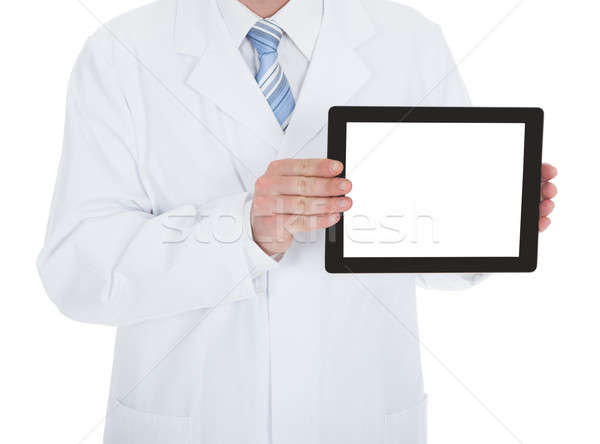 Midsection Of Doctor Displaying Digital Tablet Stock photo © AndreyPopov