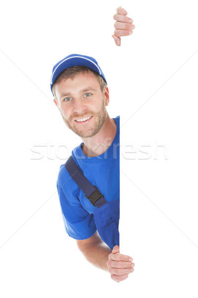 Sonriendo manual trabajador cartel retrato Foto stock © AndreyPopov