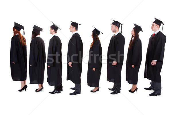 Pós-graduação estudantes em pé fila branco homem Foto stock © AndreyPopov